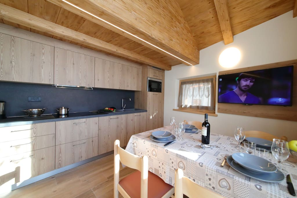 Dining area with a flat screen television