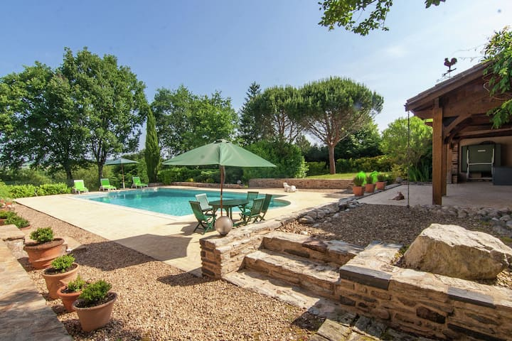 Artistically decorated spacious house with large garden and private pool.