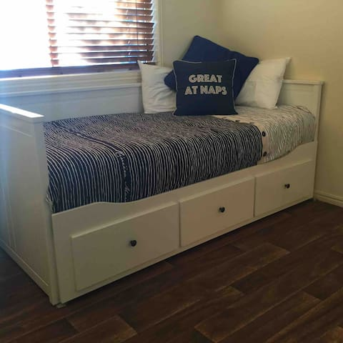 Daybed, can be a single bed or converted into a king bed.  3rd Bedroom