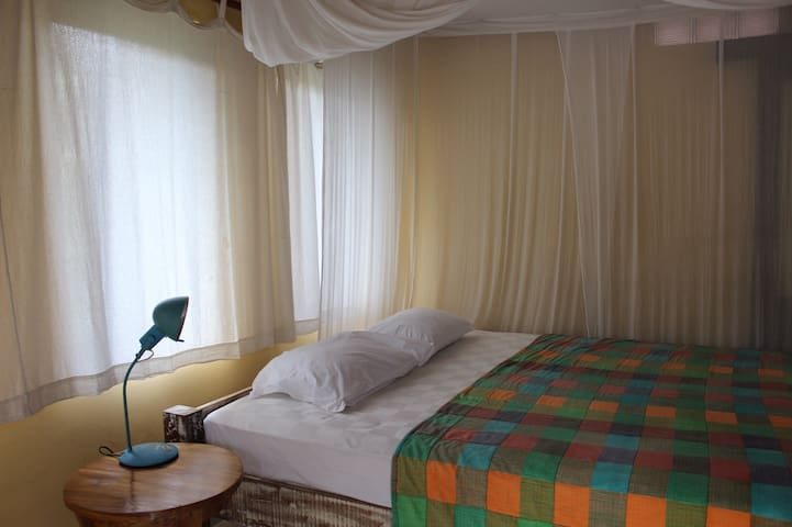 the size of the large mattress makes sleeping more comfortable and we also change sheets and bedcovers every week