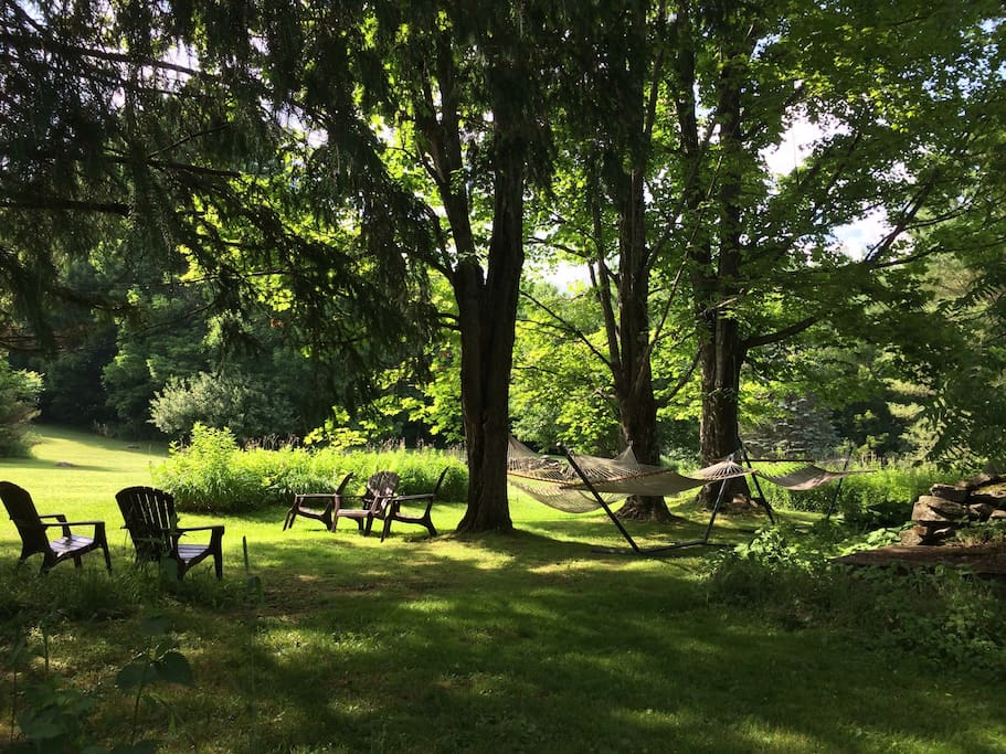 Glorious property complete with hammocks, gas grill, outdoor dinning and fire pit.