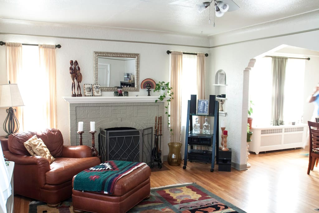 Main living area/library with wood burning fireplace