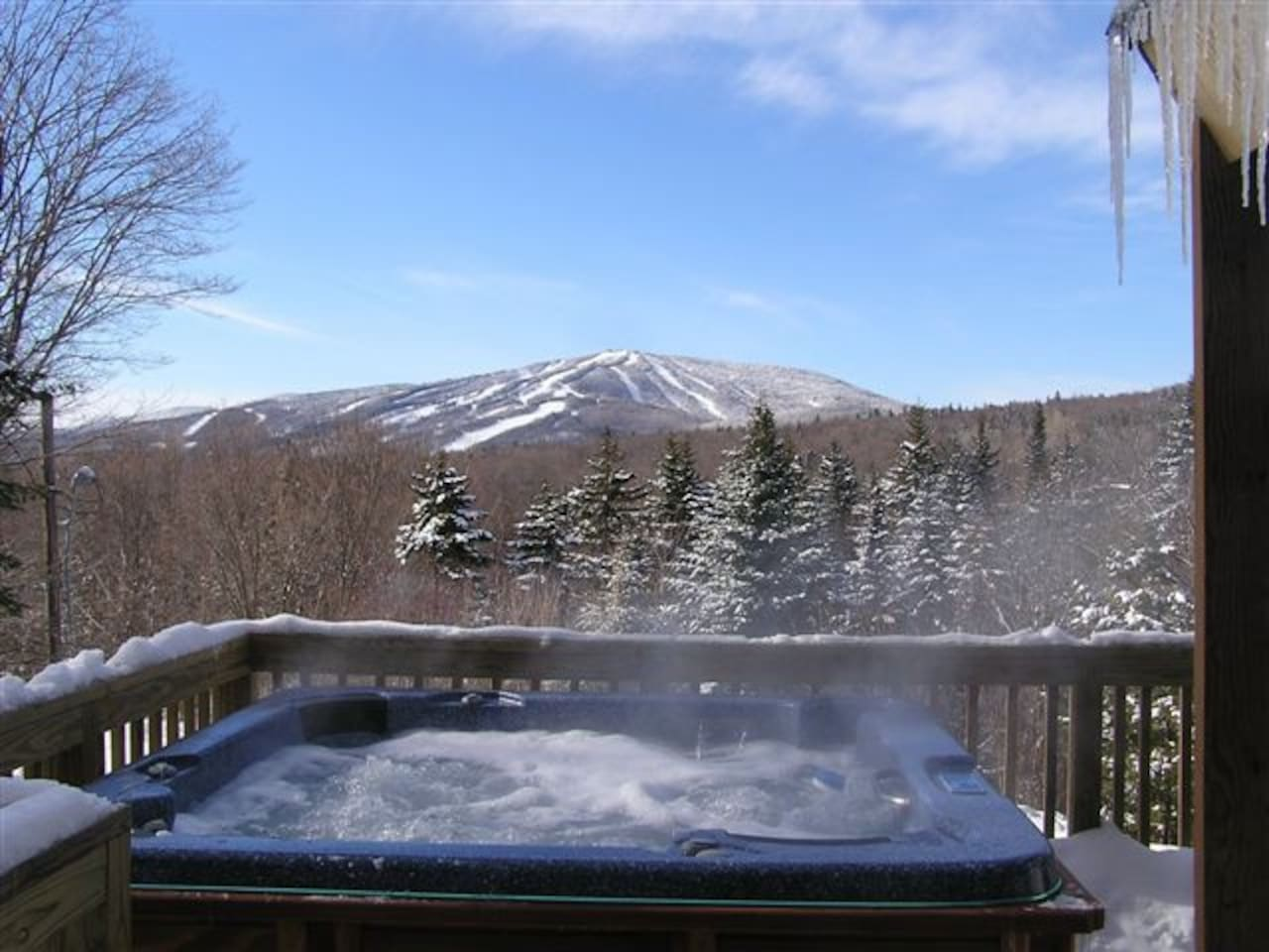 Our awesome view from the hot tub!  Relax after hitting the slopes with a cold beverage.