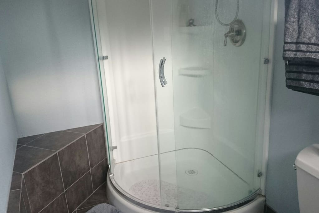 CIRCULAR GLASS SHOWER and bench