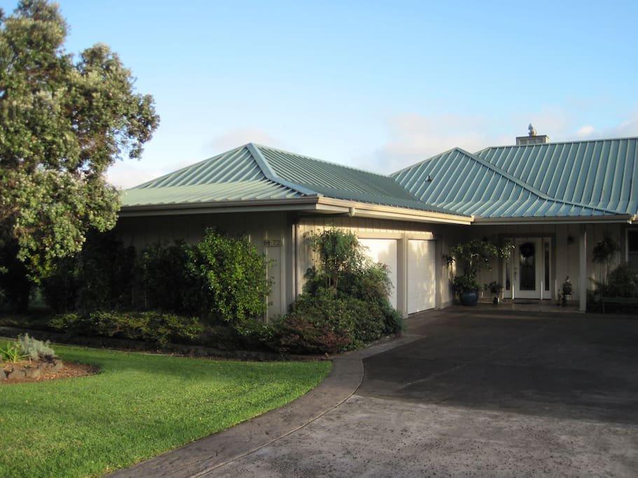 This single level and open concept home on one acre is situated on a quiet and peaceful Waimea hillside.