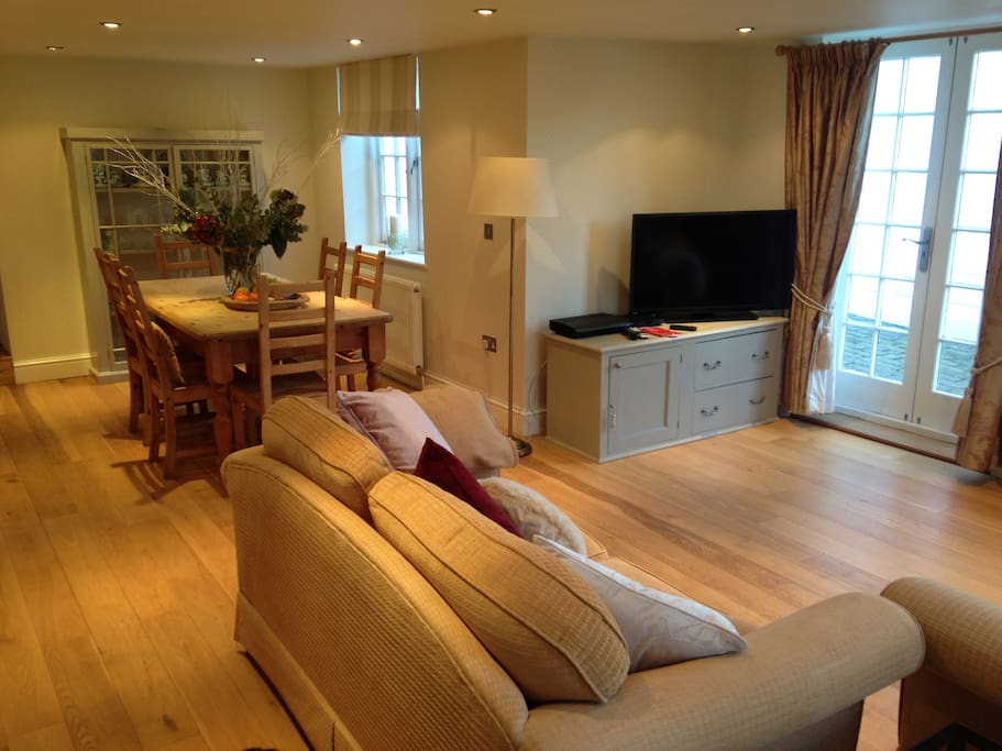 Spacious Open Plan Living Room and Dining area. Television with cable ( Virgin ) & Blu Ray DVD player.