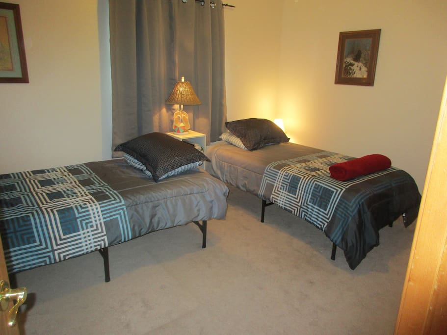 11X15 with two brand new twin beds. Both bedrooms is an automatic 3 person rate