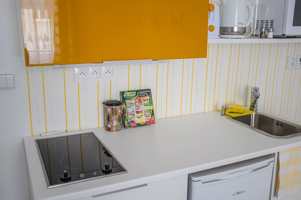 A small kitchenette with all you might need for your holiday cooking.