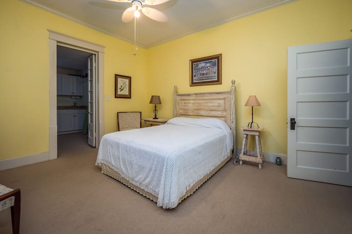 Bedroom #2. This is the darkest and coldest room in the house. It has a queen bed and a newborn infant rocking cradle. We have 2 Pack & Plays also available for your convenience.