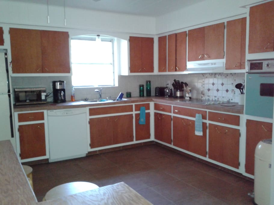 large fully furnished kitchen, refrig, dishwasher, stove and oven