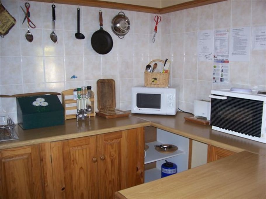 Kitchenette comes fully equipped, includes microwave and mini stove.