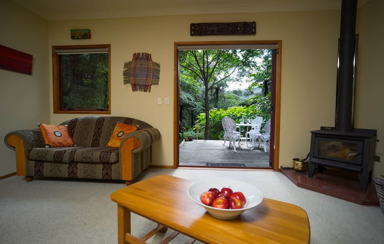 Lounge with north-facing double doors to wrap-around veranda overlooking the river.