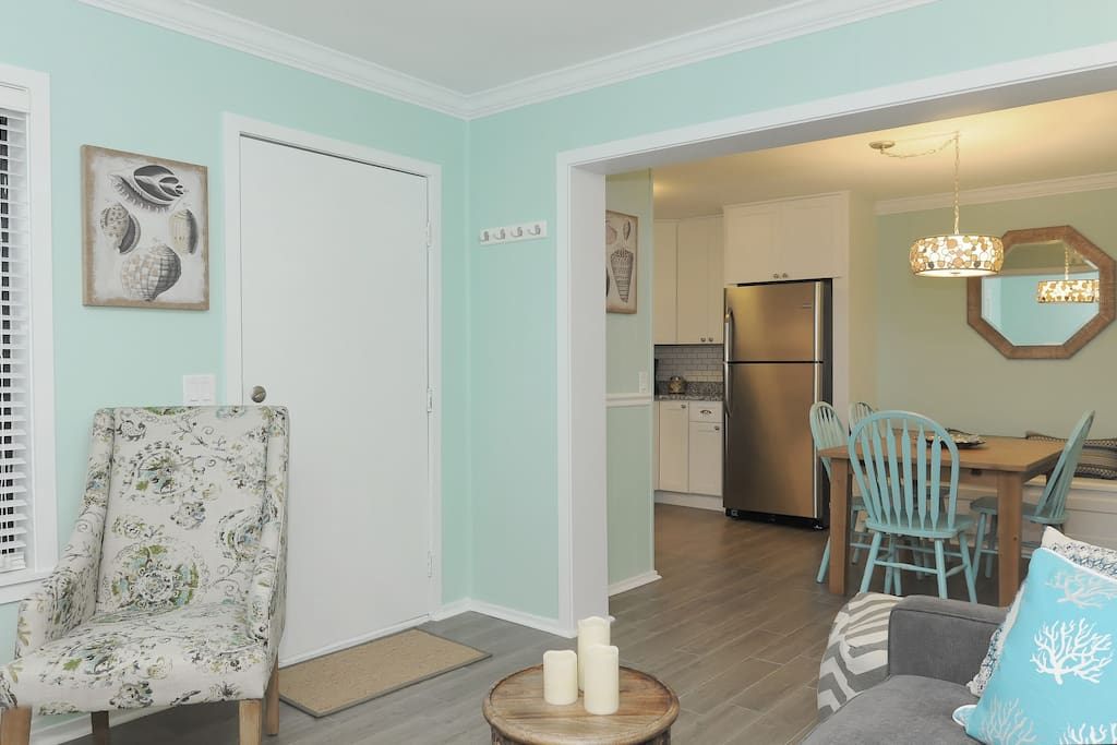 New floors, beautiful crown molding and open concept kitchen/dining & living rooms.