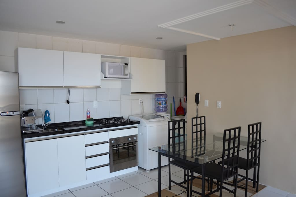 Brand new Kitchen with integrated stove, washing machine, water cooler, microwave and more
