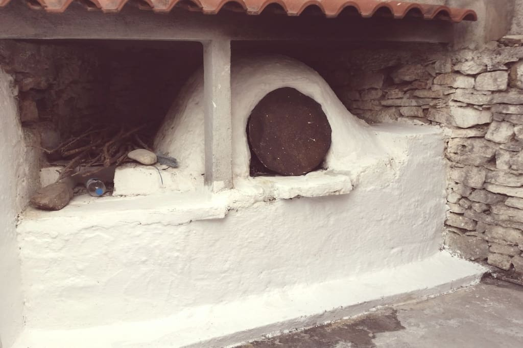 Outdoor clay oven on the small enclosed courtyard