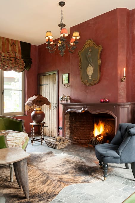 Romantic living room in your cottage with open fire place.