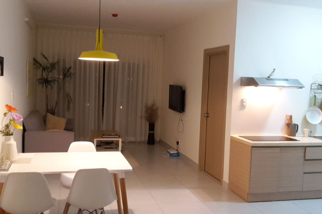 Open living area with kitchen, table, sofa...