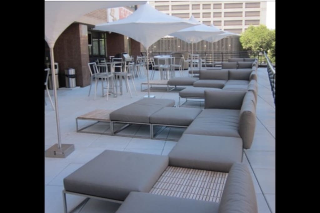 3rd floor outdoor patio with grill and vending machines.