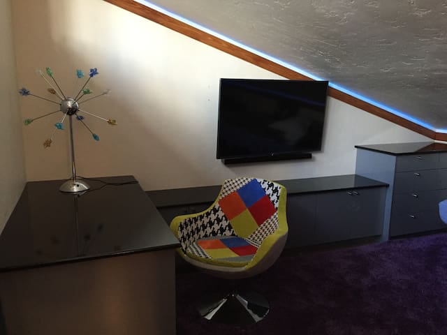 Cool child/youth bedroom on third level with large HD TV, sound bar, work space, queen size sleeping alcove and twin size trundle bed, air conditioning