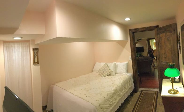 The Paris Room is a small room on the lower level with a double bed.  It is only available for one guest at a time.