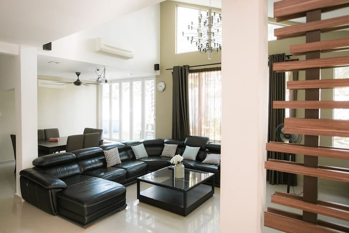 A spacious lounge greets guests as they enter into our house