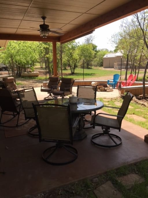 Covered Patio overlooking pond.  Join Hosts for late afternoon gathering.