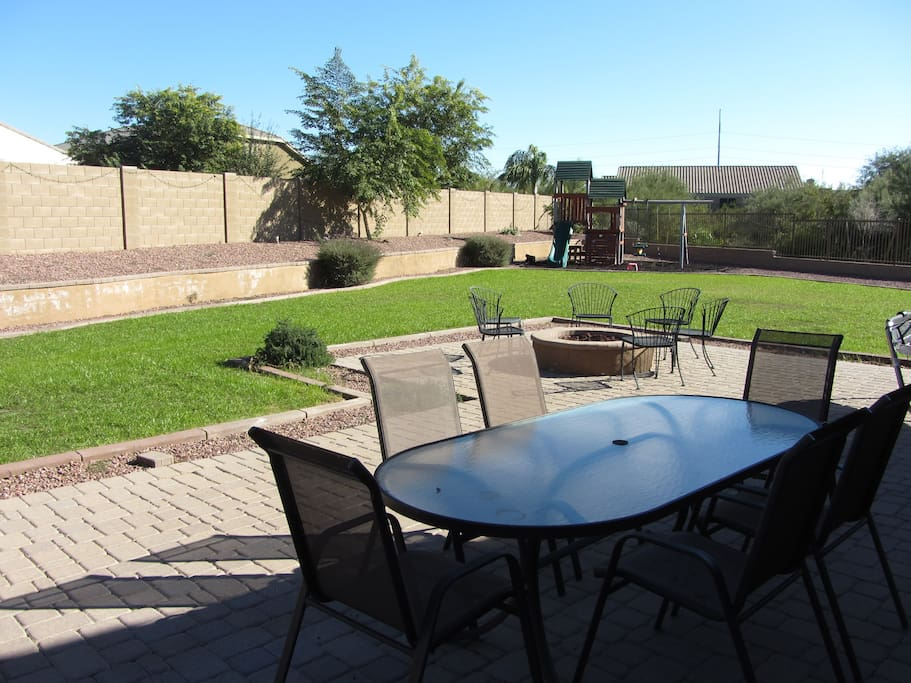 Spacious backyard with a view-through fence to a desert wash