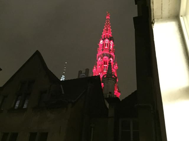 A night view from the window - the tower of the old townhall at the Grand Place