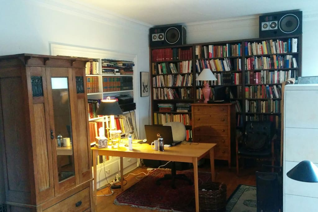 This photo shows the view from the sleeping alcove of the work table, with the armoire for clothes on the left