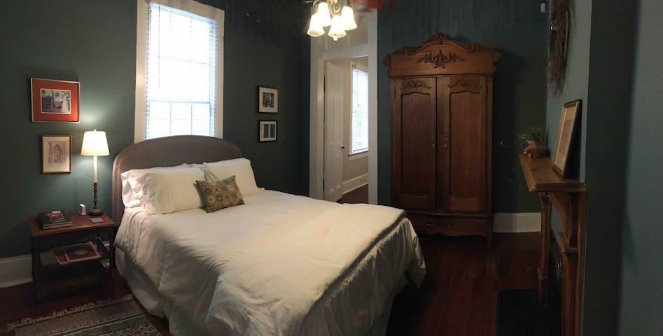 Bedroom with queen pillow top bed.