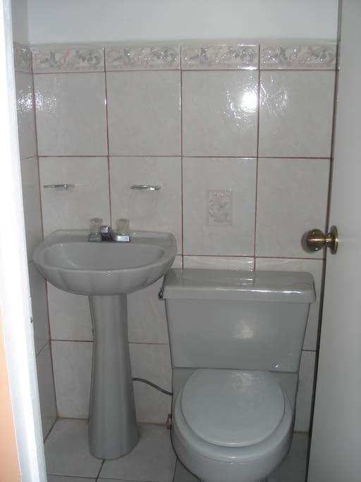 Half bathroom next to the living room