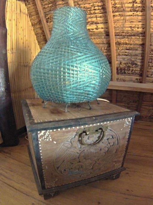Traditional accomodation in Gili Trawangan / Mama J's Saffron Cottage DECOR: handicrafted table lamp on bedside table.