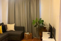 This is the living room. it also has completely blackout curtains for privacy or so that you can sleep in in the morning.