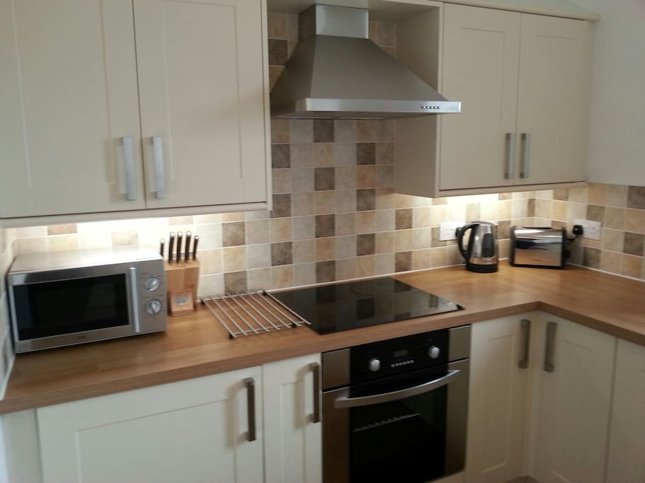 fitted modern kitchen with washer and dishwasher