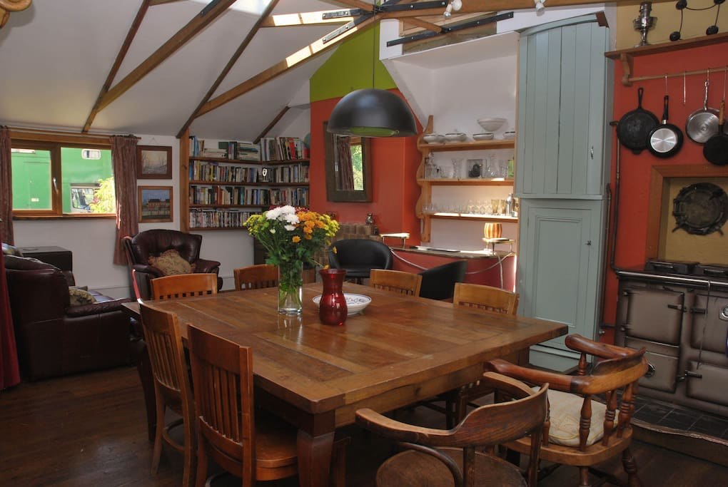 Open plan living room and kitchen. Large table, perfect for those long summer meals.