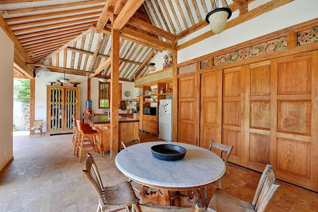 You can eat meals at the kitchen island or dining table.
