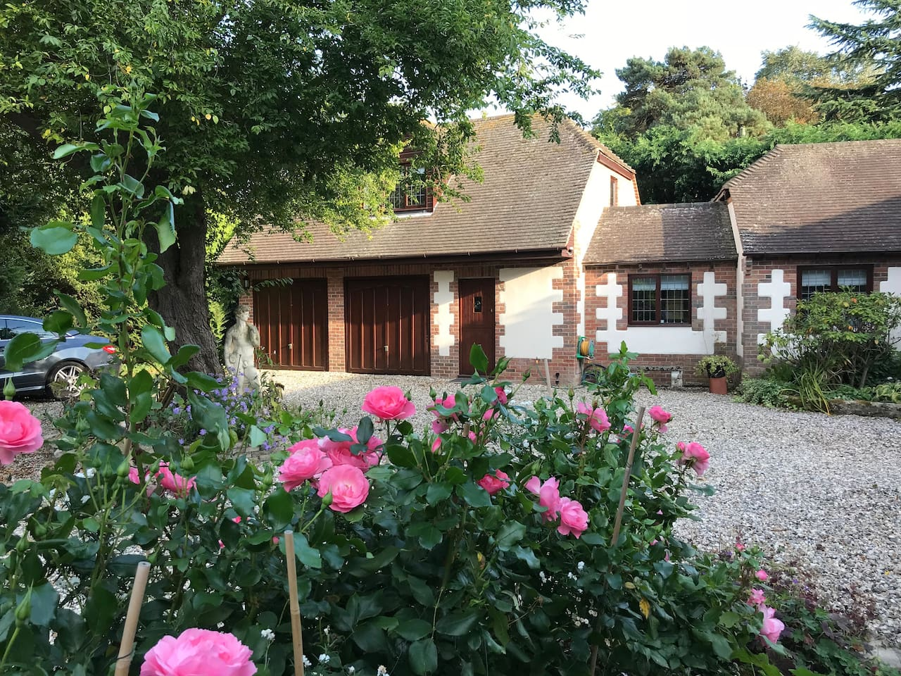 Front view of Sires Lodge annexe showing entrance door, dining room window and main bed sitting room window (above the garages). Guests are kindly requested to park immediately in front of one of the two garage doors for ease of access.