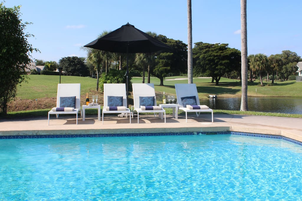 Pool overlooking 16th fairway and private lake
