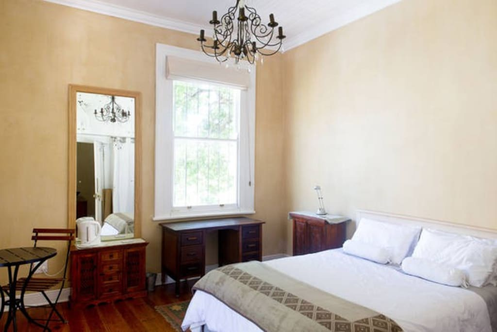 Spacious luxurious bedroom with high ceilings, balcony and ensuite bathroom. Can also be rented separately 'Large ensuite w balcony central CT'.