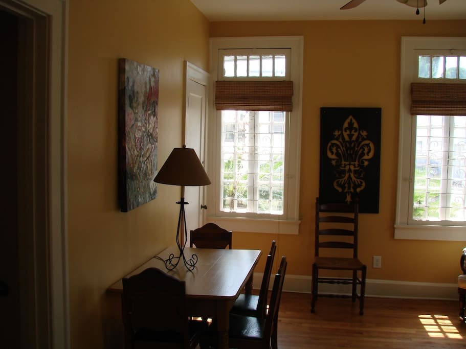 This is a cozy sitting room right off the kitchen with windows at the front of the house.  Also, a drop leaf table for dining .