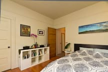 The bedroom has 9 foot ceilings, gorgeous floors, picture molding, and lots of 1928 craftsman charm with an asian/contemporary aesthetic.