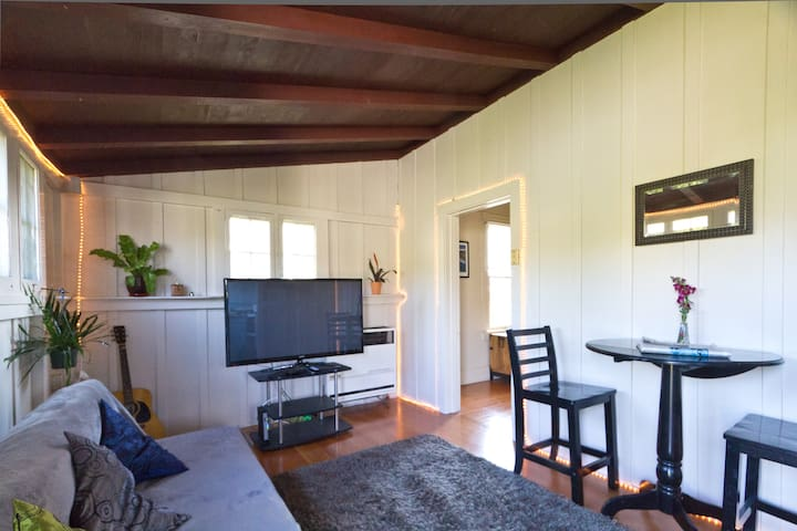 The living room has board and batt construction for a cabin-like feel.  There is now a brand new full size futon that makes a nice bed when 3 or 4 guests stay. TV has Apple TV so you can watch any streaming accounts you have.