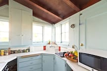 The kitchen is small but fully equipped and has a view of the mountains!