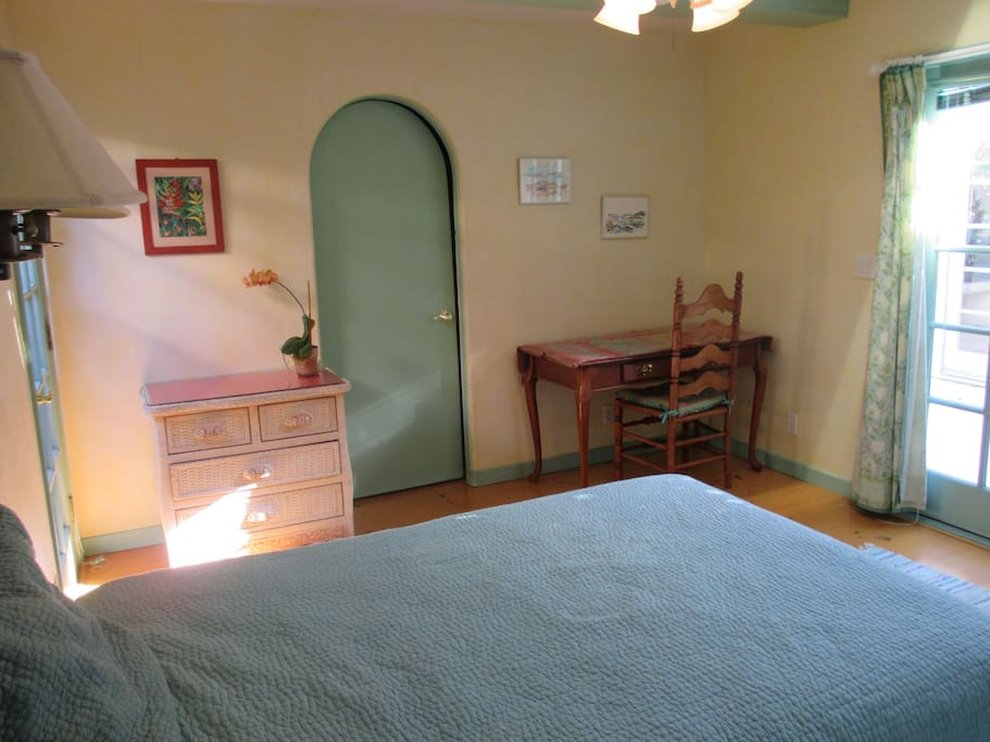 Bedroom with separate entrance, French doors to garden. Attached bathroom.