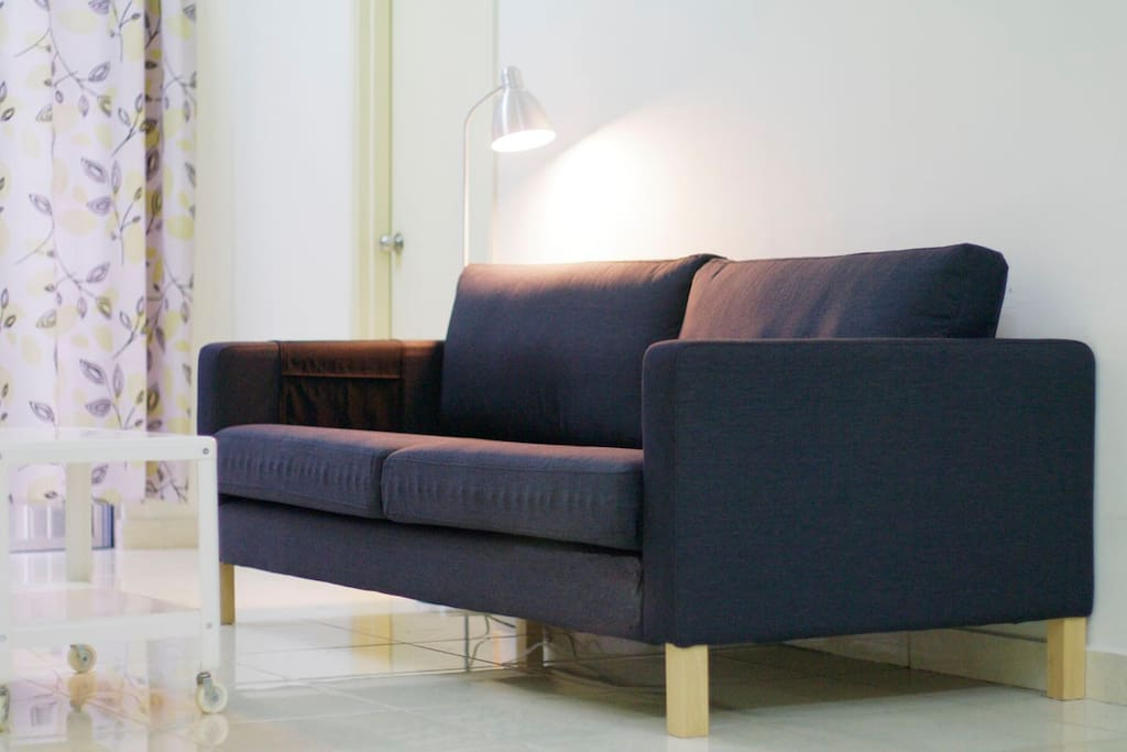 New picture IKEA sofa with reading lamp in living room