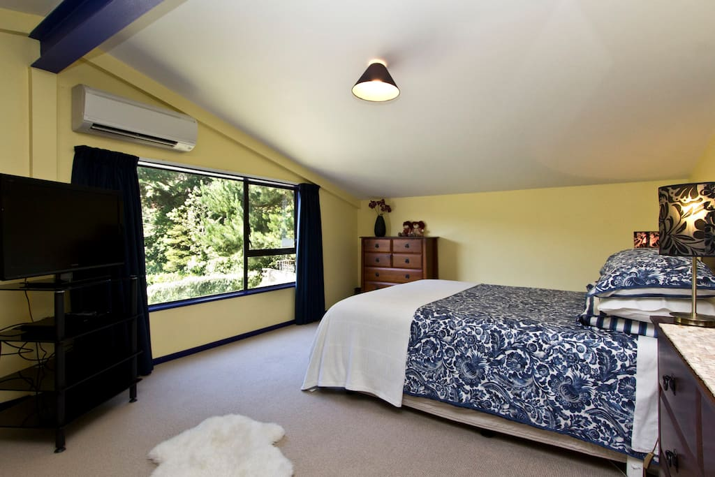 Large and sunny bedroom with extra sofa bed, air con heat pump and flat screen television.