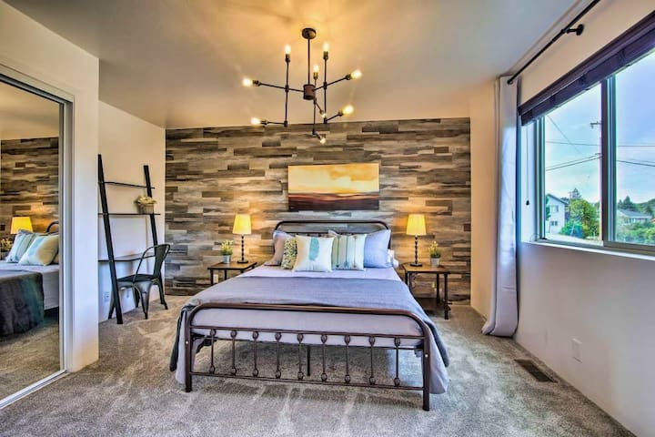 Spacious second bedroom offers an inviting queen-sized bed and work space