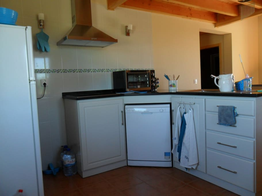 Small but fully functional kitchen.