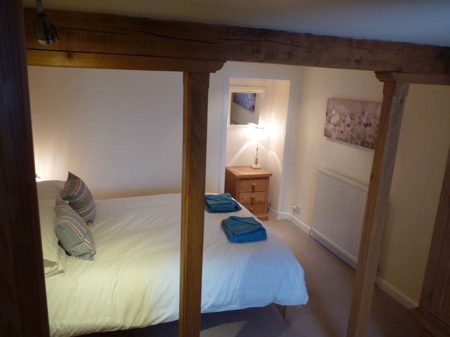 Downstairs double bedroom with oak beams