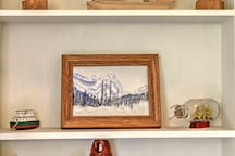 Wood carved figurines and original water color painting add a great touch to welcome our guests.